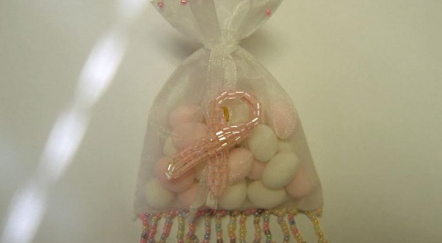 breast cancer ribbon in beaded organza bag