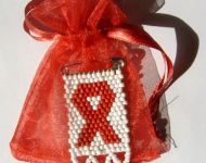 aids badge in organza bag